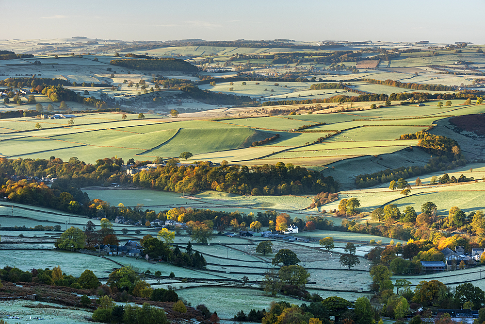 View from Curbar Edge at sunrise in autumn, looking south towards Baslow and Chatsworth, Peak District National Park, Derbyshire, England, United Kingdom, Europe