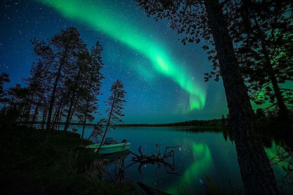 Aurora borealis reflected in Lake Pallas, Muonio, Lapland, Finland, September. - 1200-371