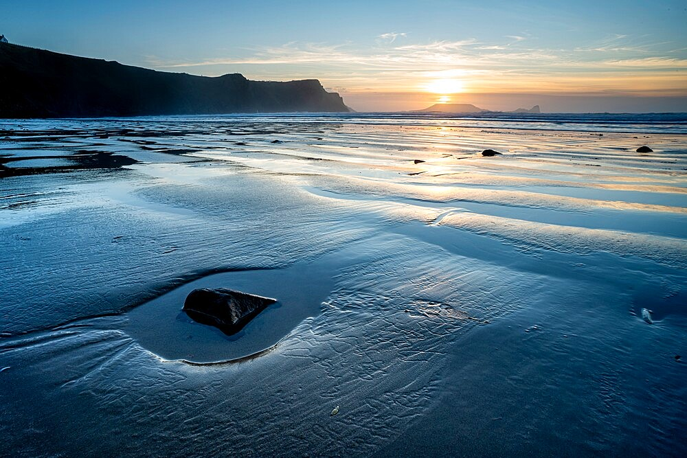 Rhossili Bay beach at low tide, at sunset, Rhossili, Gower Peninsula, Swansea, Wales. - 1200-385