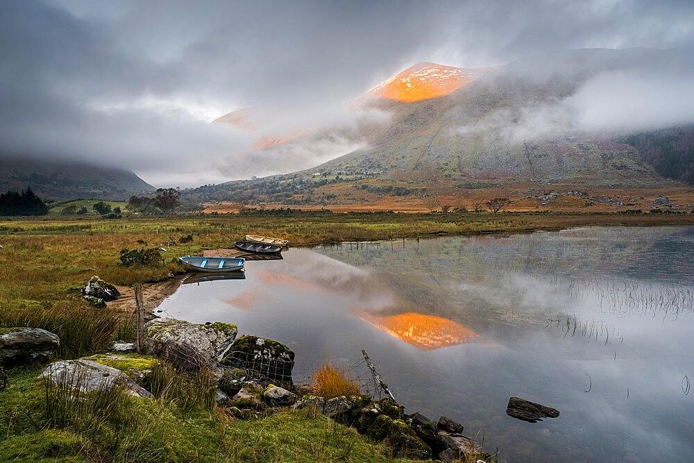 Macgillycuddy's Reeks mountains reflected in Lough Gummeenduff, evening sunlight, Black Valley, Killarney. - 1200-439