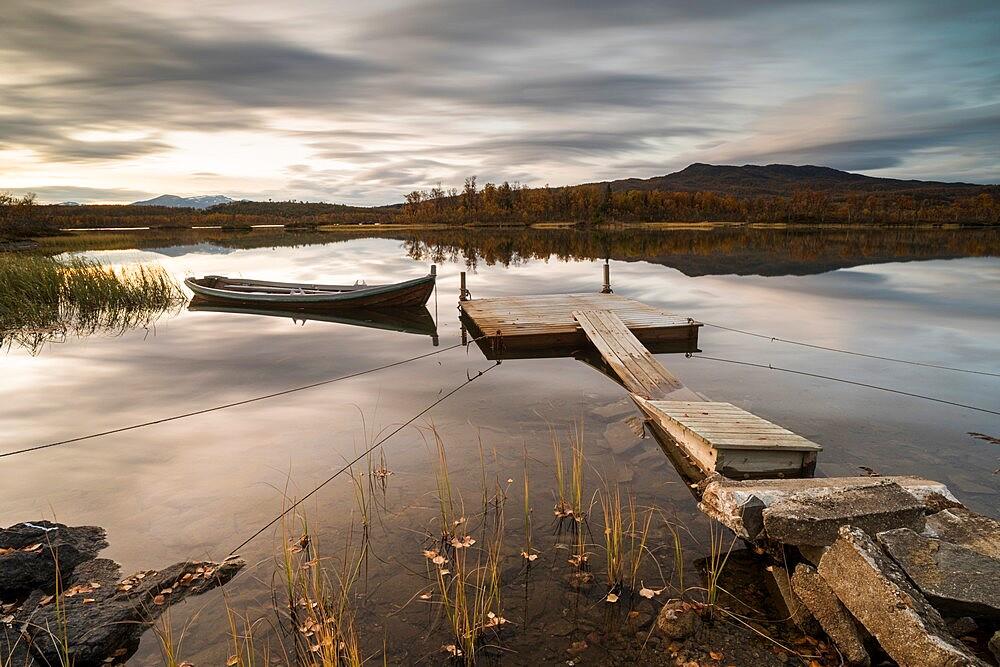 Boat moored to floating pontoon at sunset, Senja, Norway. - 1200-446