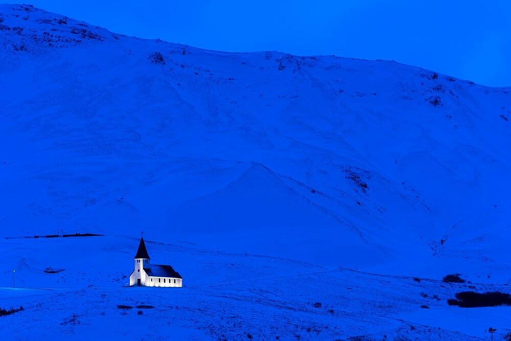 Vik Church illuminated at dawn, Vik, Iceland. - 1200-451