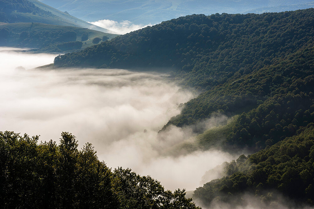 Morning clouds and mist lingering over the Monte Sibillini Mountains, Umbria, Italy, Europe - 1200-86