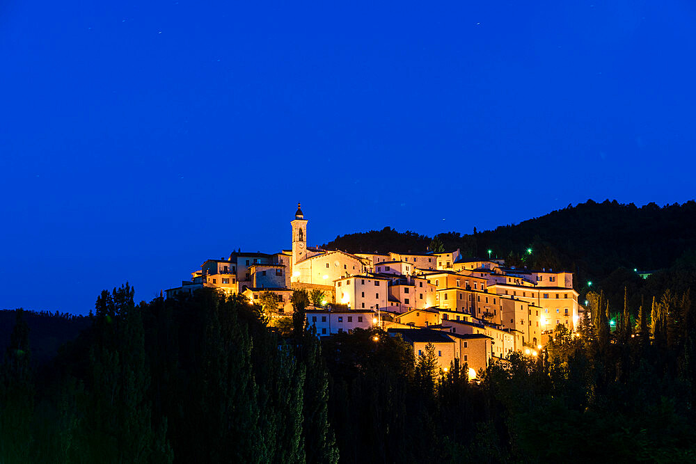 View of the village of Preci at dusk, Valnerina, Umbria, Italy, Europe - 1200-88