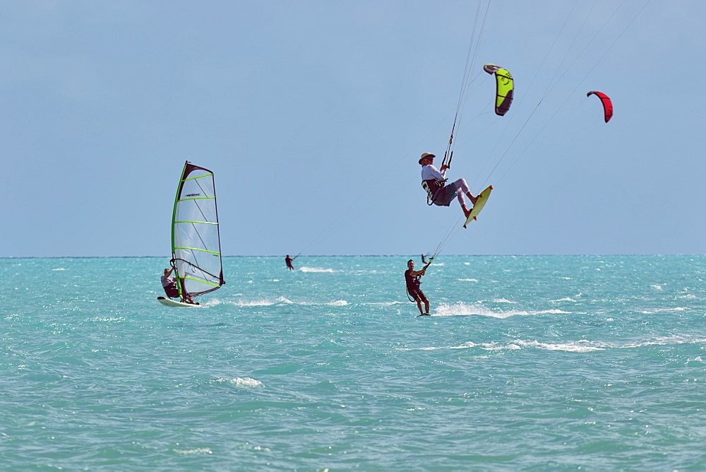 Kite-surfing and windsurfing at Long Bay Beach, on the south coast of Providenciales, Turks and Caicos, in the Caribbean.