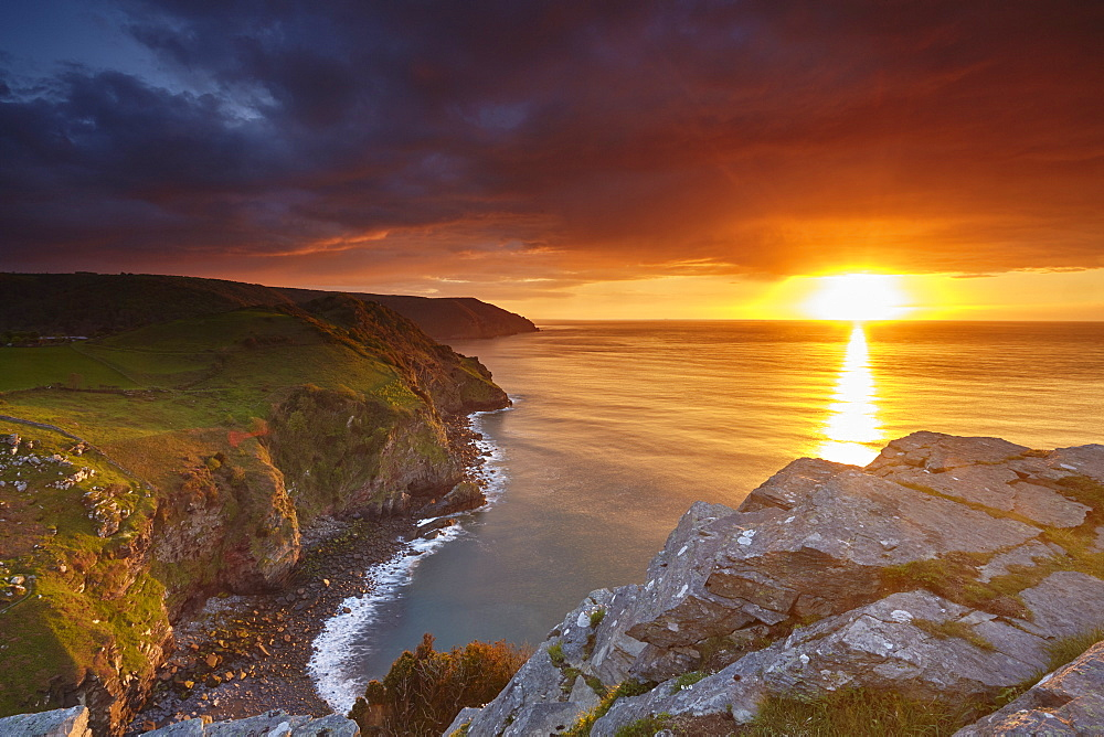 Sunset over coastal cliffs seen from the Valley of Rocks, Lynton, Exmoor National Park, Devon, England, United Kingdom, Europe