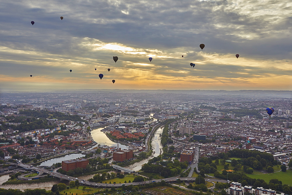 Hot-air balloons flying over the city of Bristol during the Bristol International Balloon Fiesta, Bristol, England, United Kingdom, Europe - 1202-181