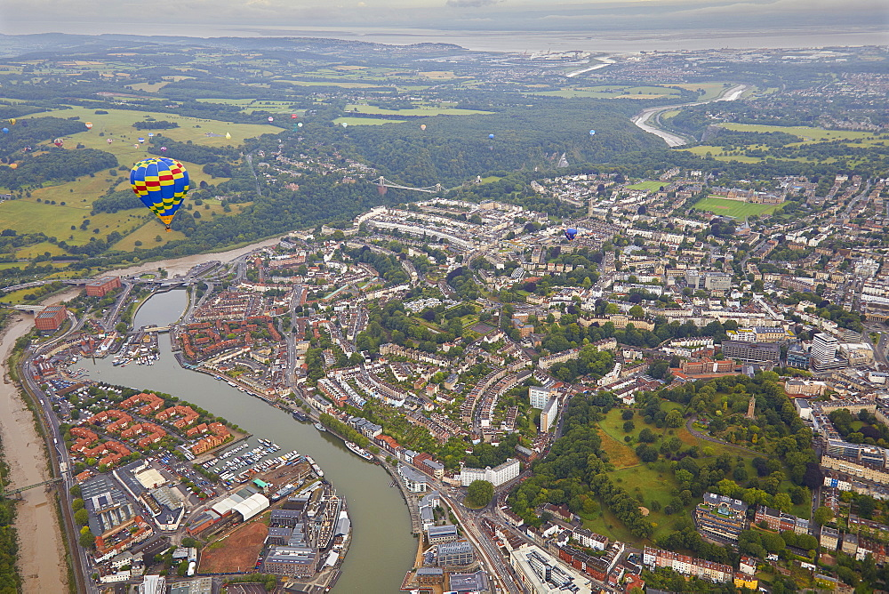 A hot-air balloon flying over the city of Bristol during the Bristol International Balloon Fiesta, Bristol, England, United Kingdom, Europe - 1202-184