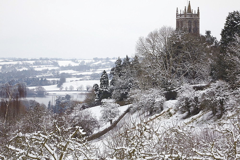 A wintry, snow-bound view of Blagdon Church, with Blagdon Lake in the background, Blagdon, Somerset, England, United Kingdom, Europe