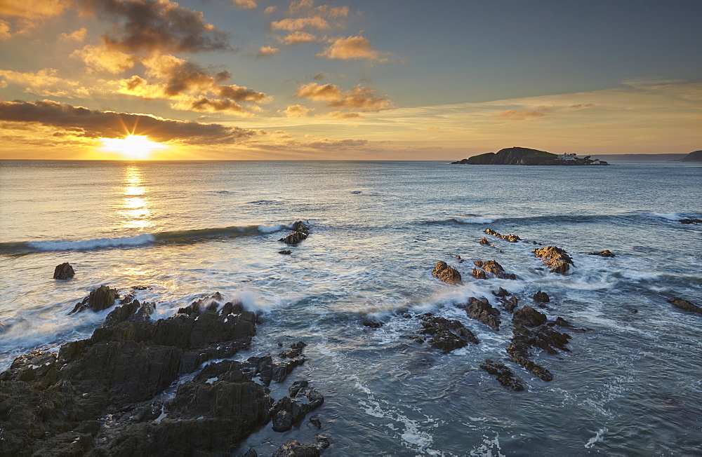 Sunset on the south coast of Devon, seen from Bantham and looking over Burgh Island, Devon, England, United Kingdom, Europe