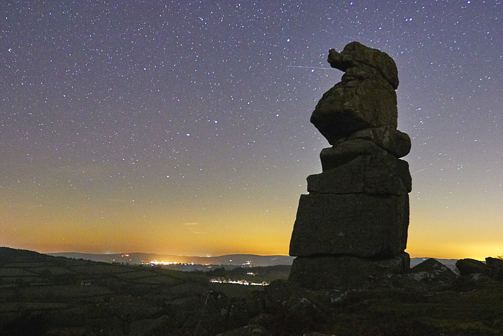 An odd natural granite outcrop against a clear night sky, Bowerman's Nose, Dartmoor National Park, Devon, England, United Kingdom, Europe