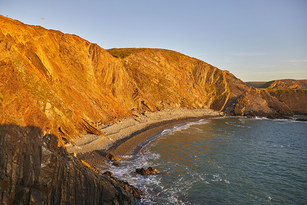 The cliffs of Devon's Atlantic coast, at Hartland Quay, seen during a calm evening sunset, Devon, England, United Kingdom, Europe
