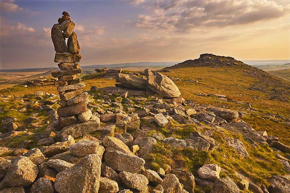 Granite boulders on the summit of Rough Tor, one of the highest points of Bodmin Moor, lit by evening sunlight, north Cornwall.