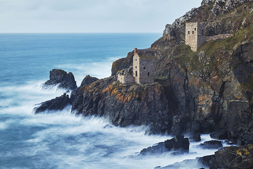A dusk view of the iconic cliffside ruins of Botallack tin mine, UNESCO World Heritage Site, near St. Just, near Penzance, in west Cornwall, England, United Kingdom, Europe - 1202-294