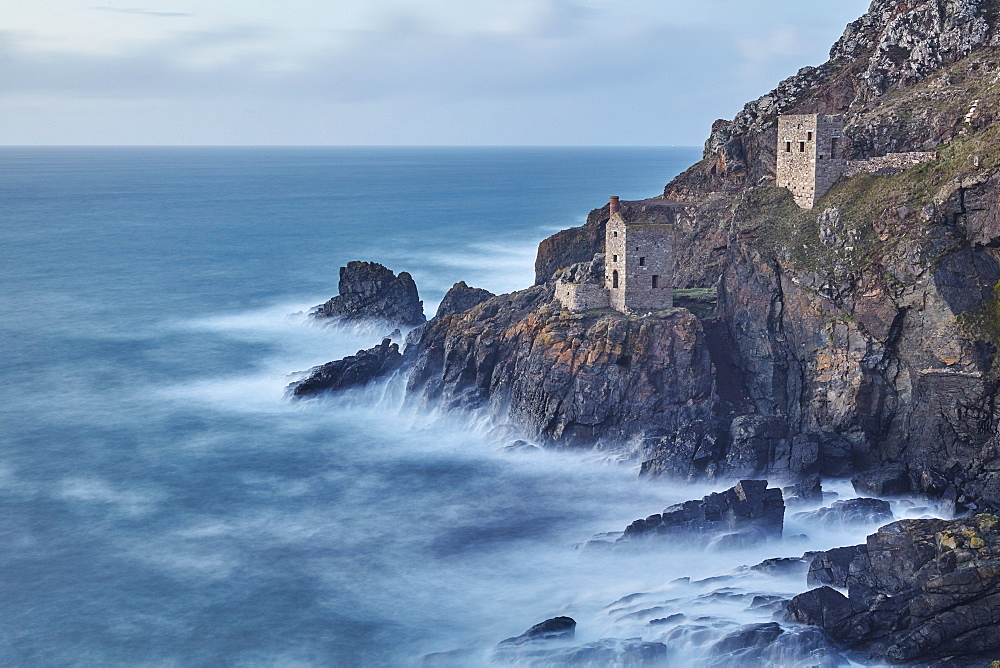A dusk view of the iconic cliffside ruins of Botallack tin mine, UNESCO World Heritage Site, near St. Just, near Penzance, in west Cornwall, England, United Kingdom, Europe - 1202-296