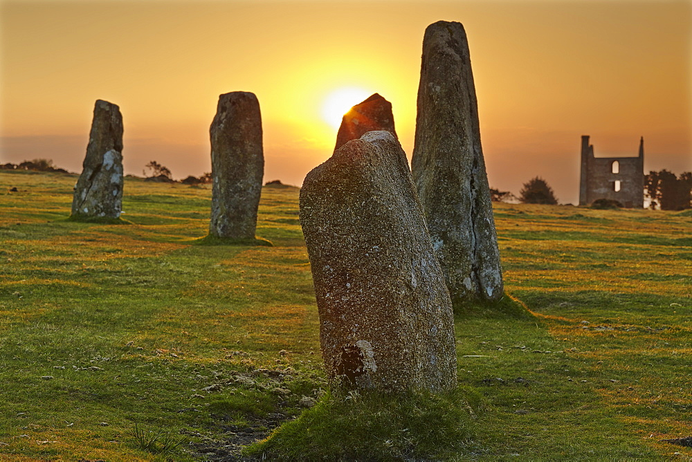 Sunrise over standing stones at the Hurlers, a series of prehistoric stone circles on Bodmin Moor, near Liskeard, east Cornwall, England, United Kingdom, Europe