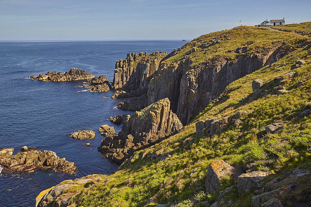 The rugged cliffs of Land's End, Britain's most southwesterly point, in calm summer weather, near Penzance, west Cornwall.