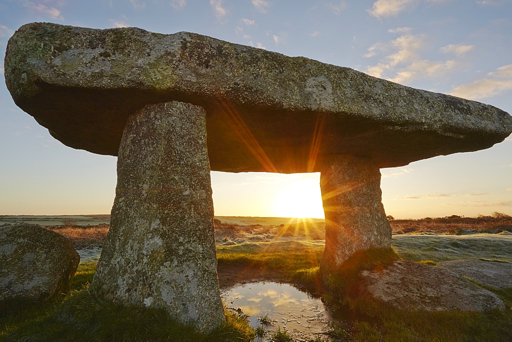 A sunrise view of the remains of a prehistoric burial chamber, known as Lanyon Quoit, near Penzance, west Cornwall, England, United Kingdom, Europe