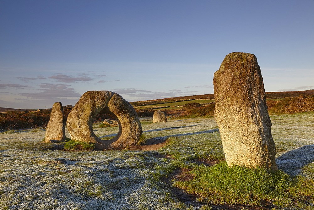 The mysterious prehistoric Men-an-Tol ring stone on a frosty morning, in a field near Penzance, in west Cornwall.