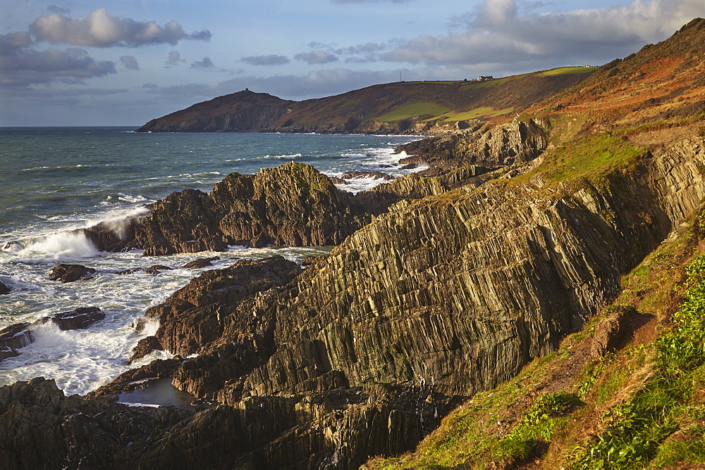 The rocky coast of Penlee Point, looking towards Rame Head and at the mouth of Plymouth Sound, east Cornwall.