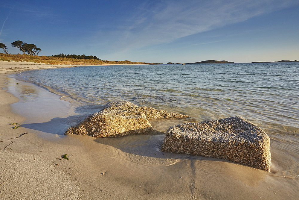 Granite boulders, a typical feature of the Isles of Scilly, seen along the shore in Pentle Bay, on the island of Tresco, Isles of Scilly, England, United Kingdom, Europe