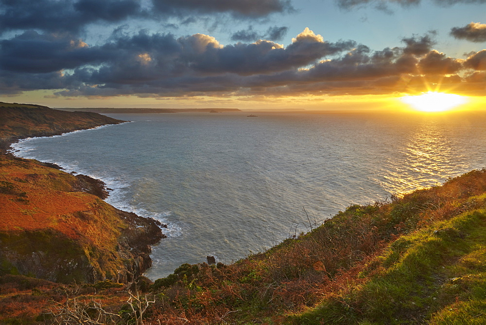 Early morning view of the cliffs at Rame Head, looking towards Penlee Point and the entrance to Plymouth Sound, in east Cornwall