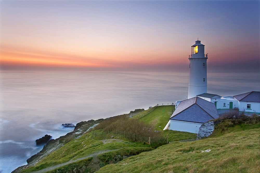 A peaceful dusk on Cornwall's Atlantic coast, showing the lighthouse at Trevose Head, near Padstow, Cornwall, England, United Kingdom, Europe - 1202-353