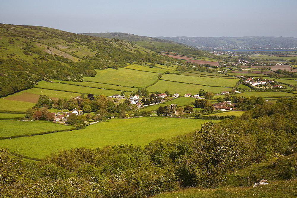 A view across countyside from Crook Peak along the southern slopes of the Mendip Hills, near Cheddar, Somerset, Great Britain.
