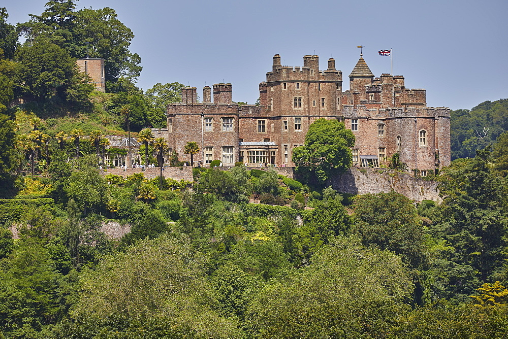 The historic Dunster Castle, on the edge of the village of Dunster, in Exmoor National Park, Somerset, Great Britain.