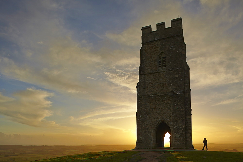 St Michael's Tower silhouetted at sunset, on the summit of Glastonbury Tor, Glastonbury, in Somerset, Great Britain.
