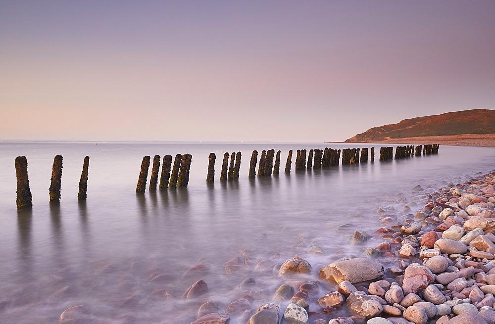 A dusk view of rotting sea defences on the pebble beach at Porlock Weir, near Porlock, in Exmoor National Park, Somerset, England, United Kingdom, Europe - 1202-382