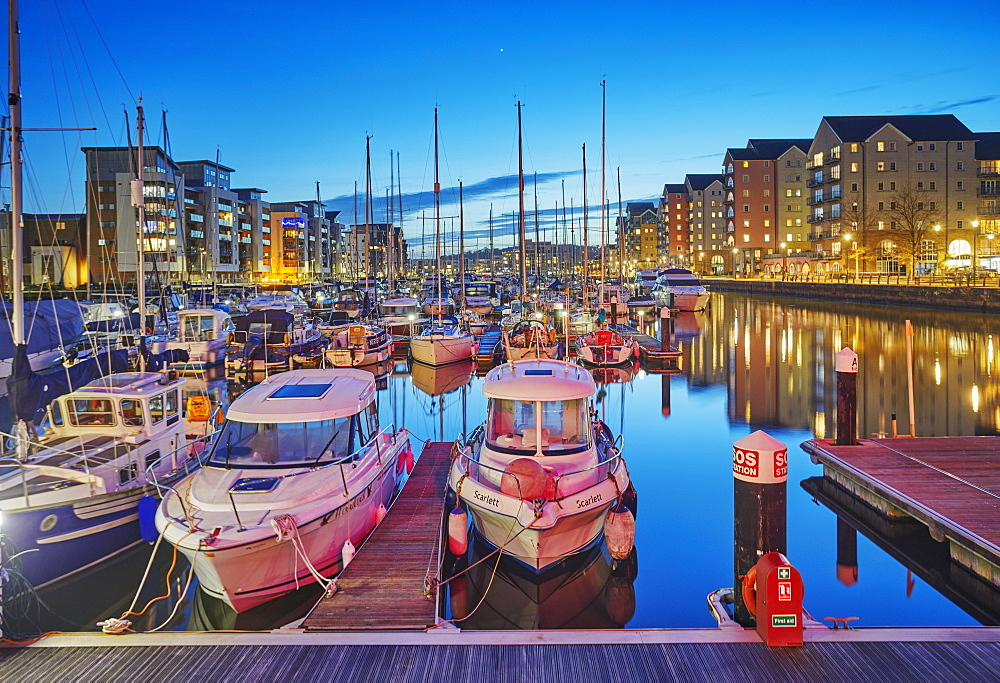 A dusk view of the modernised harbour and marina at Portishead, near Bristol, in Somerset, Great Britain.