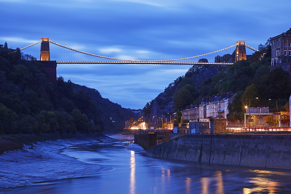 Dusk over the 19th century Clifton Suspension Bridge, spanning the Avon Gorge in the Clifton district of Bristol, Great Britain.