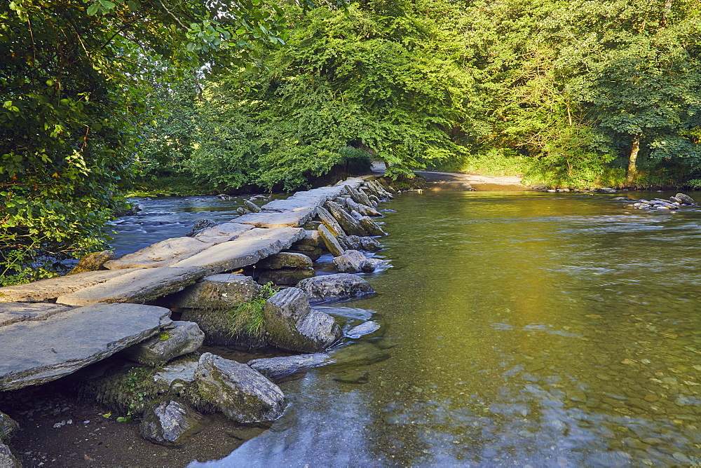 The prehistoric slab stone bridge, Tarr Steps, crossing the River Barle, near Dulverton, in Exmoor National Park, Somerset.