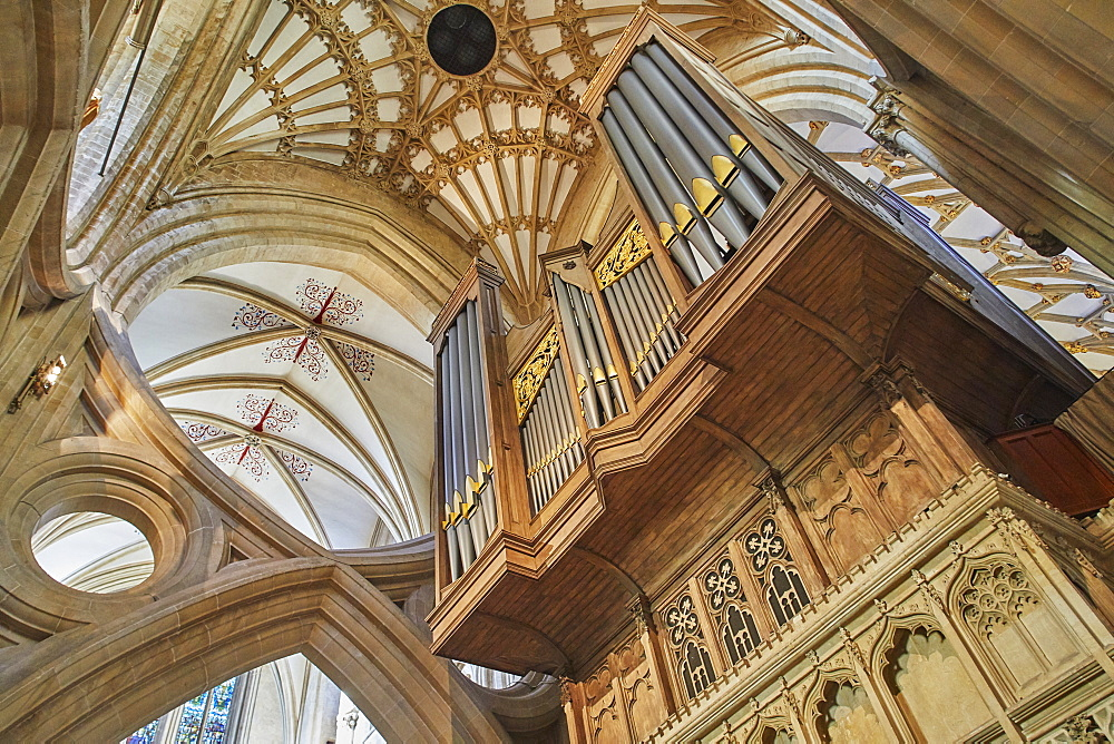 The massive organ and the ceiling in Wells Cathedral, in Wells, Somerset, Great Britain.