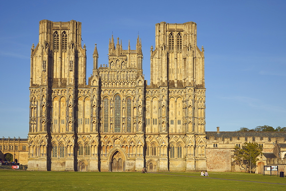 The historic western facade of Wells Cathedral, with its twin square towers, in Wells, Somerset, Great Britain.