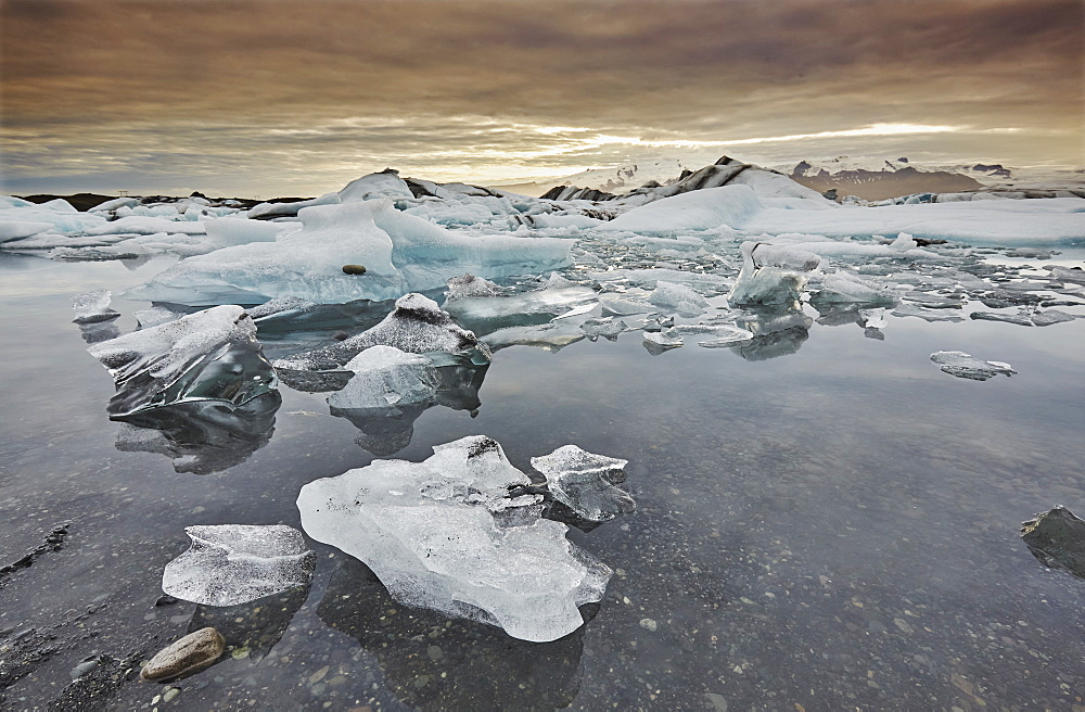 An iconic Icelandic landscape, an ice-filled lagoon fed by the Vatnajokull icecap, at Jokulsarlon, on the south coast of Iceland, Polar Regions - 1202-421