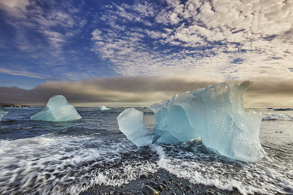 Melting glacial ice, carved from the Vatnajokull icecap, on the beach at Jokulsarlon, on the south coast of Iceland, Polar Regions - 1202-425