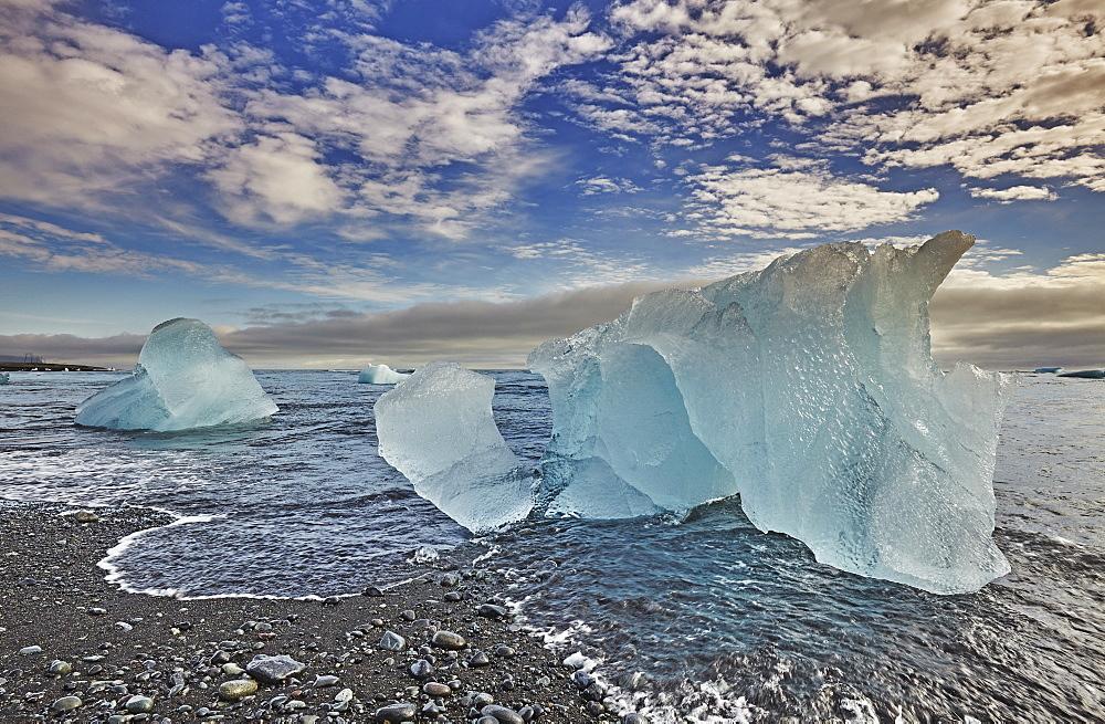 Melting glacial ice, carved from the Vatnajokull icecap, on the beach at Jokulsarlon, on the south coast of Iceland, Polar Regions - 1202-426