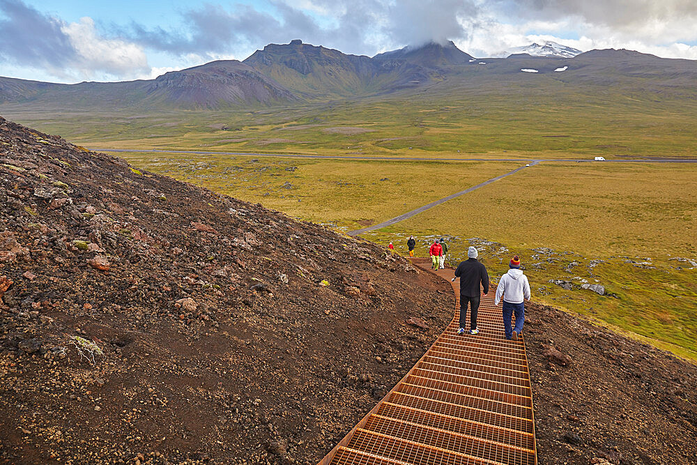 Exploring a volcanic landscape on a footpath up Saxholl cinder cone and crater, Snaefellsjokull National Park, western Iceland, Polar Regions - 1202-441