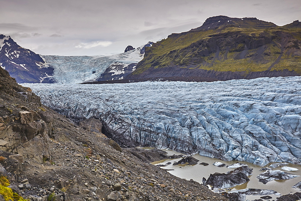 A retreating glacier, pouring down from the Vatnajokull icecap, in Skaftafell National Park, southern Iceland, Polar Regions - 1202-451