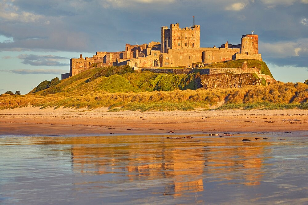 Bamburgh Castle and its beach, at Bamburgh, near Seahouses, Northumberland, England, United Kingdom, Europe - 1202-474