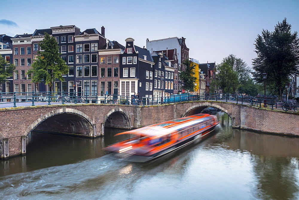 A boat going under a bridge over the Keizersgracht canal, Amsterdam, Netherlands - 1207-138