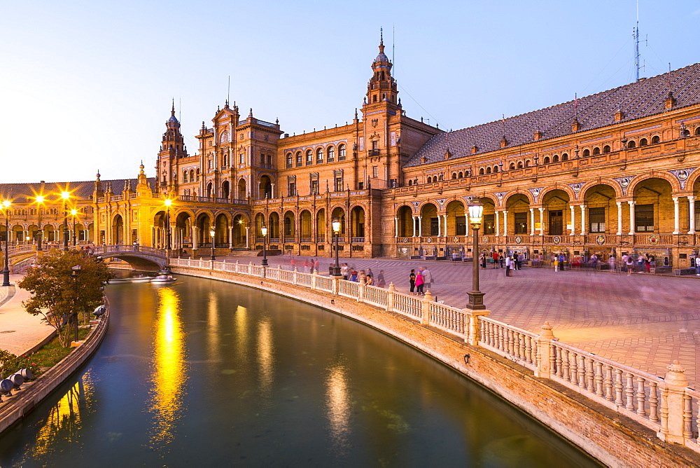 Plaza de Espana at dusk, built for the Ibero-American Exposition of 1929, Seville, Andalucia, Spain, Europe