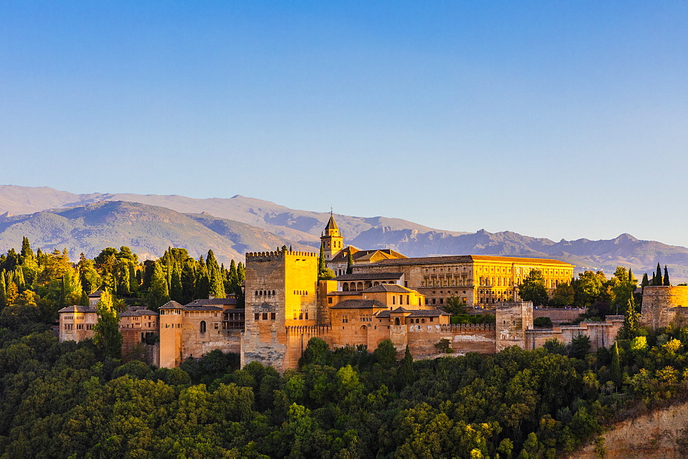 View of Alhambra, UNESCO World Heritage Site, and Sierra Nevada mountains, Granada, Andalucia, Spain, Europe