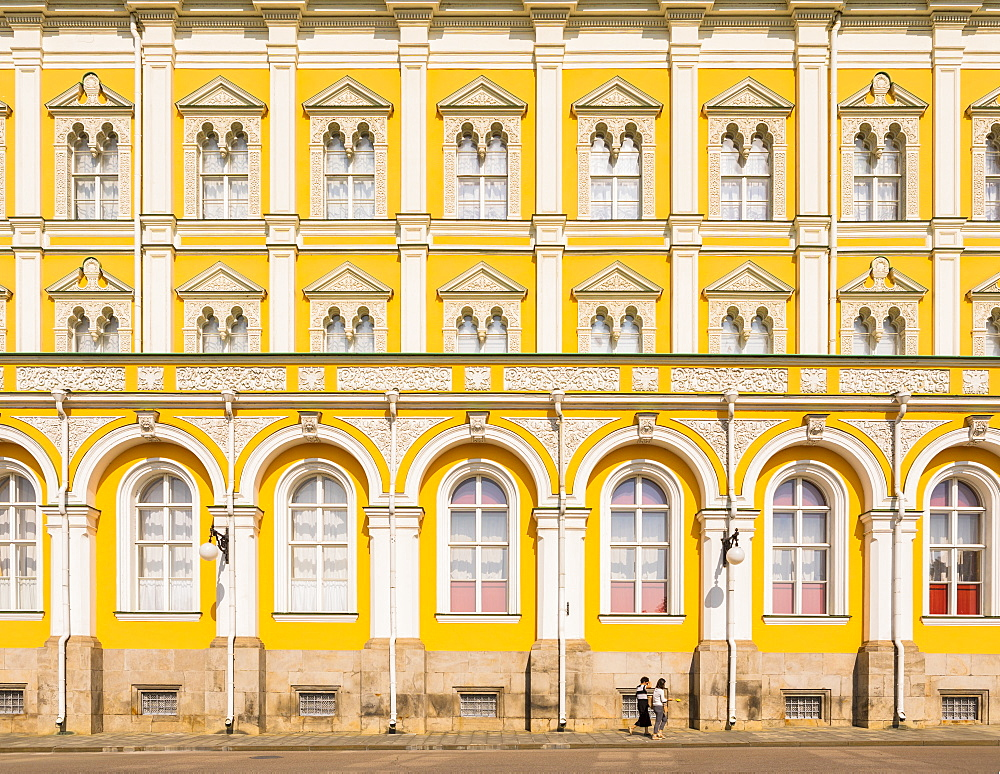 Two women walking in the Kremlin in front of Grand Kremlin Palace, UNESCO World Heritage Site, Moscow, Russia, Europe