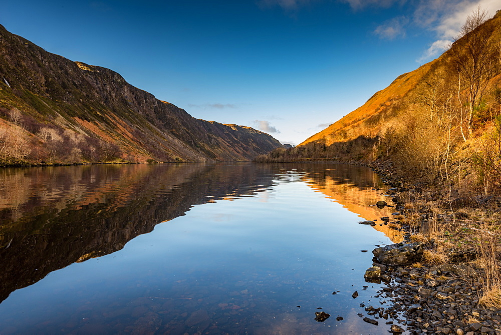 Early morning sunlight hits the waters of Loch Awe, Highlands, Scotland, UK