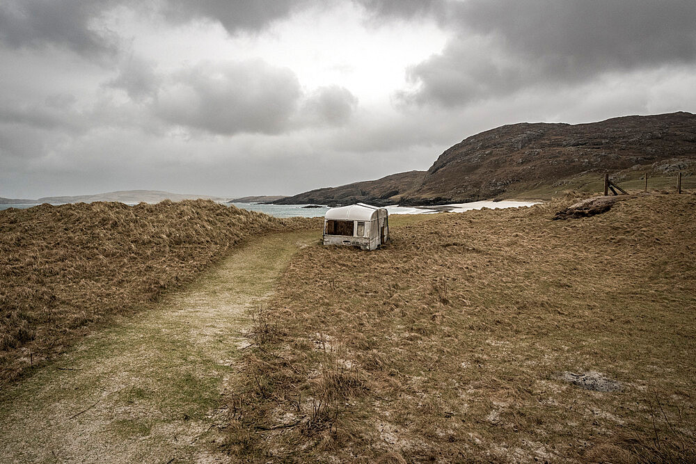 Abandoned caravan at Cleit Beach, Barra, Outer Hebrids. Storm. Rain.