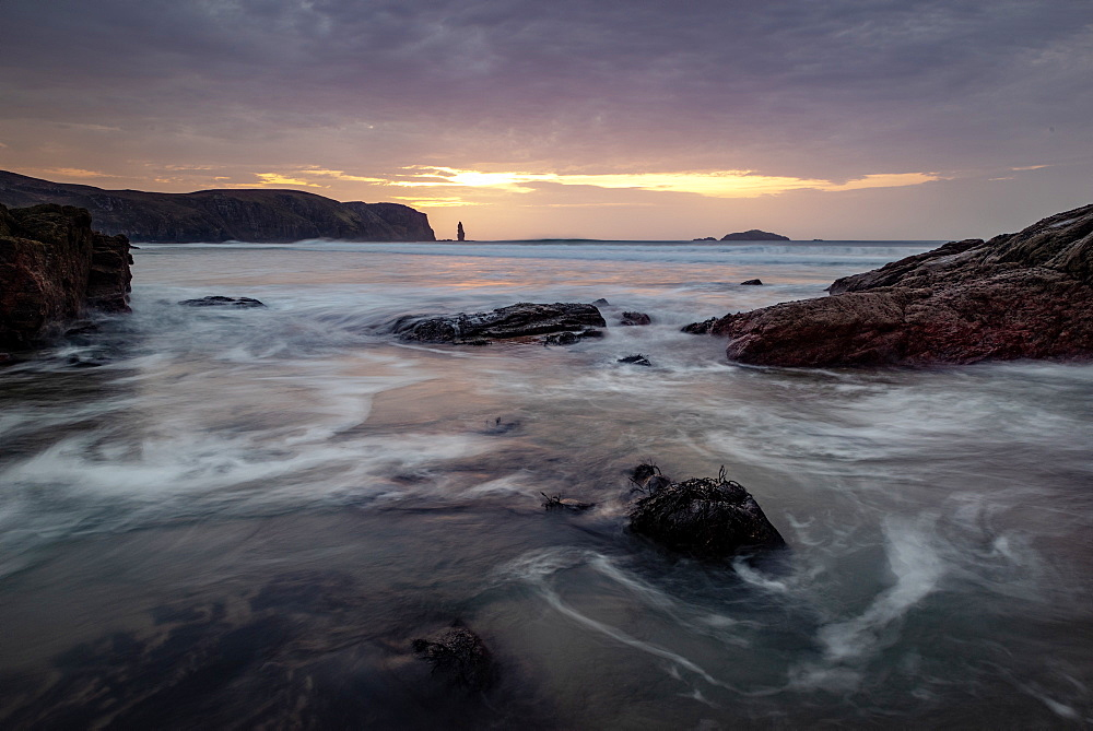 Am Buachaille sea stack, Sandwood Bay, Scotland. Sunset.