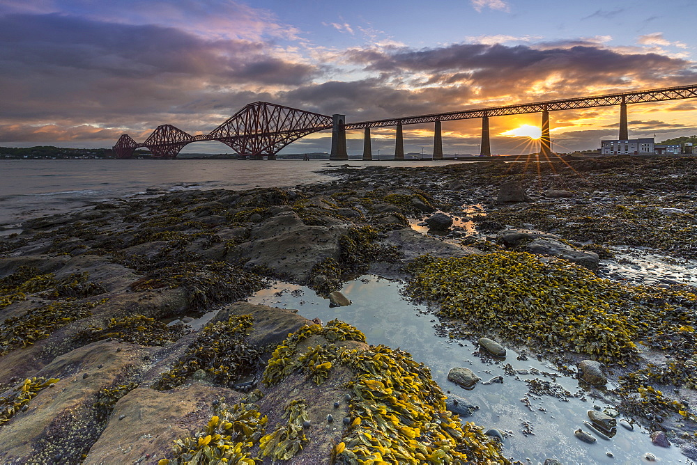 Sunrise through the Forth Rail Bridge, UNESCO World Heritage Site, on the Firth of Forth, South Queensferry, Edinburgh, Lothian, Scotland, United Kingdom, Europe